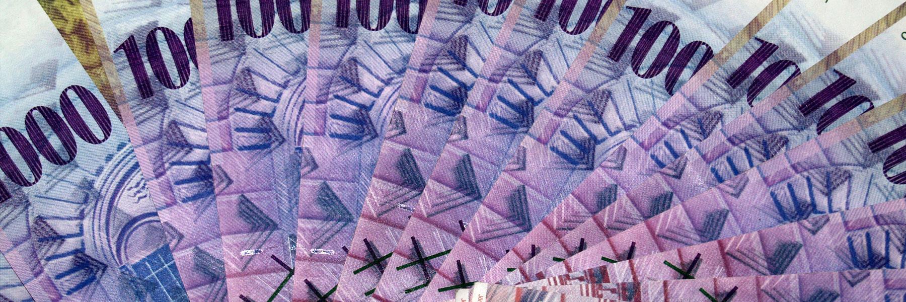 Des finances plus saines pour Belmont – Liasse de billets de banque suisses